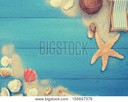Vacation concept background with starfish and deckchair on blue vintage plank
