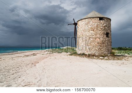 Old windmill on Gyra beach, Lefkada Greece