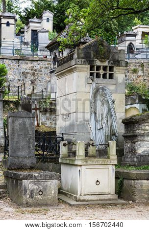 Paris France - Jule 11 2016: View of Pere Lachaise cemetery. World's most visited cemetery attracting thousands of visitors to graves of those who have enhanced French life over past 200 years.