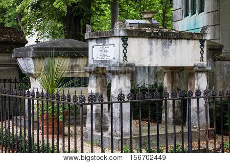 Paris France - Jule 11 2016: La Fontaine's and Moliere's graves at Pere Lachaise cemetery. World's most visited cemetery attracting thousands of visitors to graves of those who have enhanced French life over past 200 years.