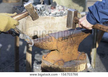 two blacksmith forges detail. Blacksmith working outdoors.