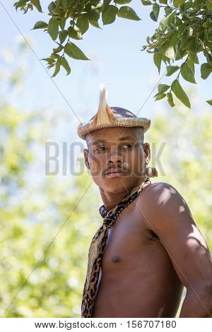 Lesedi Cultural Village, SOUTH AFRICA - 4 November 2016: Zulu tribesmen wearing impala skin headdress. Zulu is one of the five main tribes in South Africa known for their fighting skills.