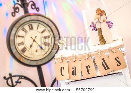 collection of decorative wedding display ornaments with vintage clock in the background