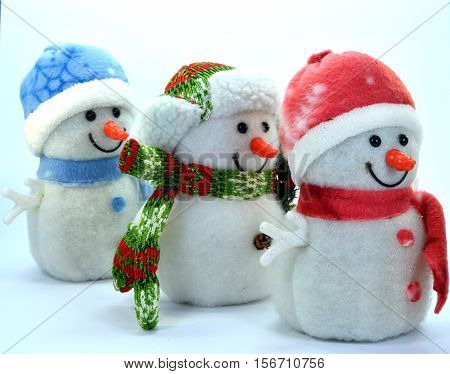 Trio of snowman in a row on a white background