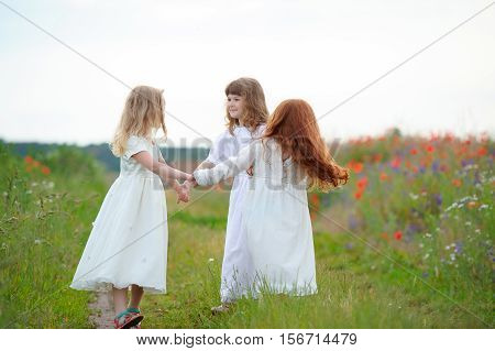 happy children dancing on a field healthy life kid's togetherness and happiness concept