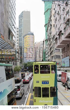 Hong Kong - October 17, 2016: Hong Kong cityscape view with double-deck Tramways, Ding Ding