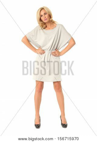 Full Length Of Flirtatious Woman In Tunic Dress Isolated On White
