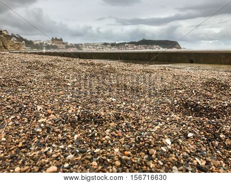 SCARBOROUGH ENGLAND - NOVEMBER 6: Gravel dredged up by storm onto South Bay sea front. In Scarborough England. On 6th November 2016.