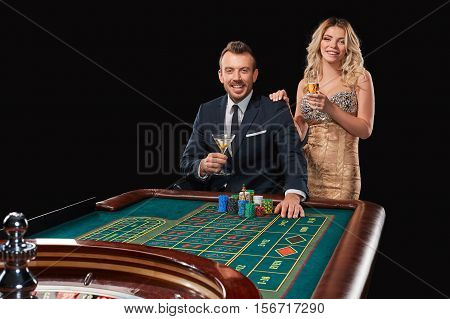 Couple playing roulette wins at the casino. Addiction to the gambling. happy win