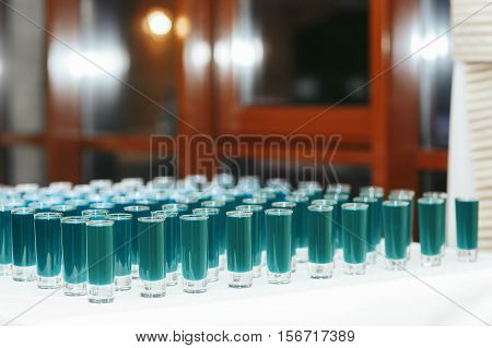 Light Blue Shots On The White Table