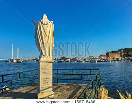 SANTA MARGHERITA LIGURE, ITALY - SEPTEMBER 2016 : Statue of Santa Margherita facing sea at Tigullio Gulf of Santa Margherita Ligure, Italy on September 22, 2016. She prays for safe return of fishermen