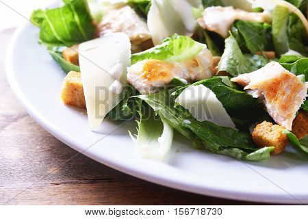 salad ceaser with chicken close up. shallow doff