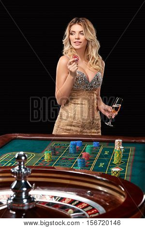 woman in a smart dress plays roulette. addiction to gambling