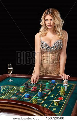 woman in a smart dress plays roulette. addiction to gambling. bets, throwing chips