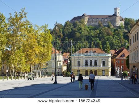 Ljubljana Slovenia - September 25 2016: City center. Congress Square and Slovenian Philharmonic. In the background on the hill is visiable the Ljubljana Castle.