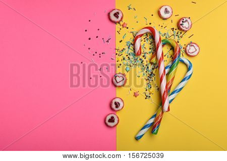 Candies And Sprinkles On Colorful Background