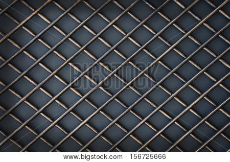 The door of forged metal lattice on gray background