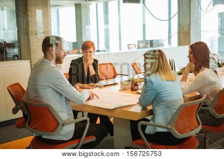 Team of business people having a meeting in a conference room.