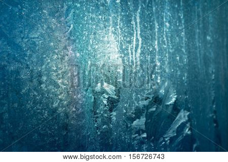 Turquoise Frost Background, Closeup Frozen Winter Window Pane Coated Shiny Icy Frost Patterns, Extreme North Low Temperature, Natural Ice Pattern on a Frosty Glass