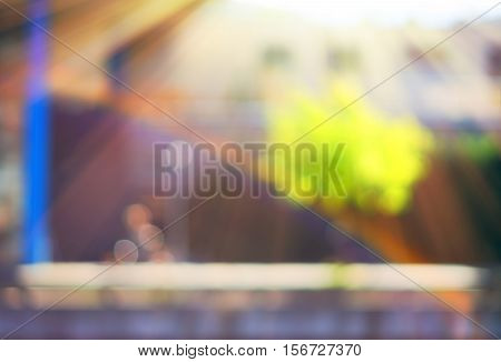 Man riding bicycle with rainbow on Trondheim street bokeh background hd