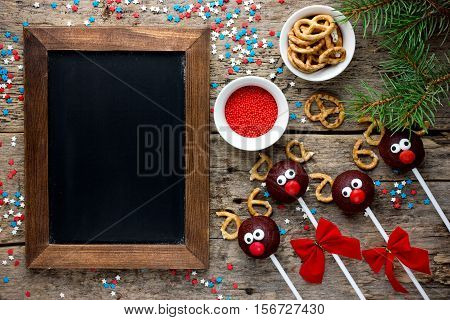 Reindeer cake pops Christmas treat for kids holiday food background empty space for text in chalkboard