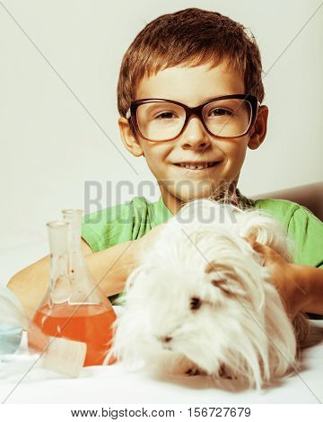 little cute boy with medicine glass isolated wearing glasses smiling close up science concept