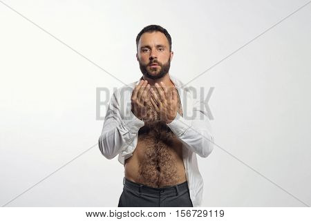 Handsome emotional man pleading or begging a gray background