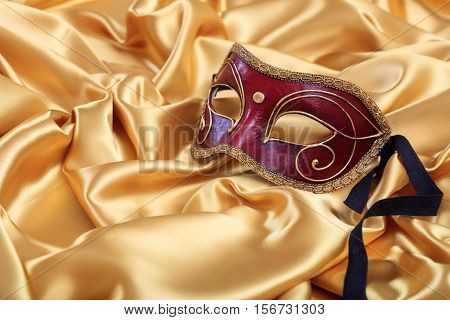Carnival Mask Isolated On Golden Satin Background