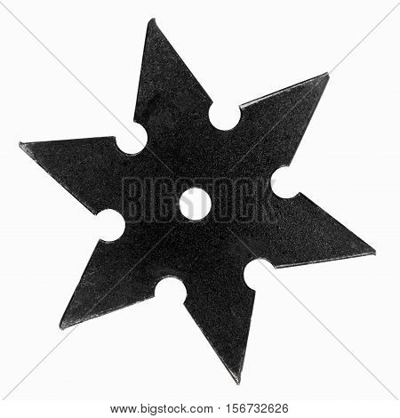 Black shuriken with star shape isolated on white background.