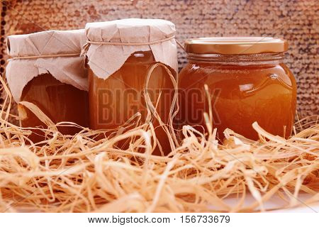 jar with fresh honey and honey comb