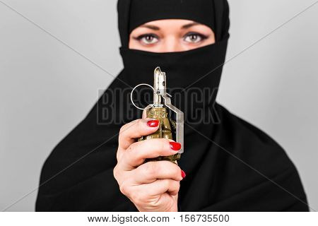Hand grenade in a woman's hand close-up. The concept of terrorism and war.