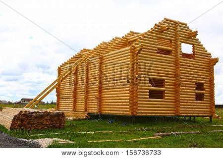 Wooden house from round logs under construction