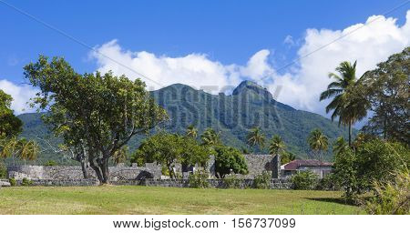 ruins of a sugarcane plantation with volcano in background, St Kitts.