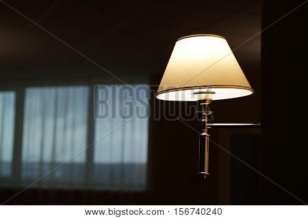 Lamp On Wall In Hallway At Night