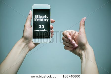 Black Friday sale - holiday shopping concept - text on mobile phone in female hands