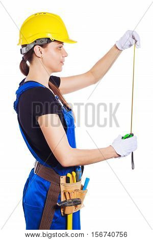 Woman Builder In The Uniform Holds A Brick