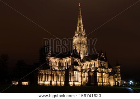 Salisbury Cathedral at night. Tallest spire in the UK on Anglican cathedral in early English architectural style in Wiltshire England