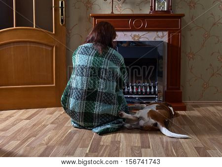 Woman In The Plaid With The Beagle Near The Fireplace