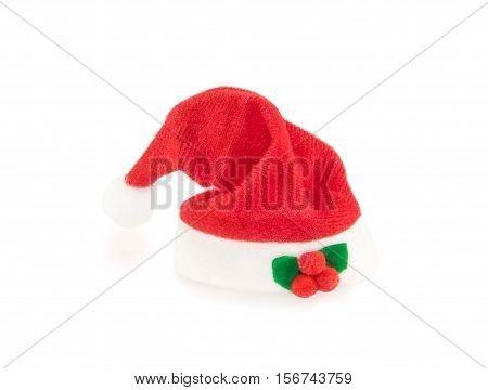 Red Santa hat with decoration isolated over white. Christmas and New Year theme.