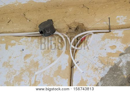 house wall in electric wires assembly electrical wiring in the room