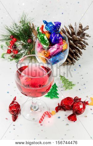 Christmas Party Celebrations With Wine And Colorful Wrapped Sweets.