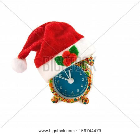 Funny colorful alarm clock with Santa hat isolated over white background.