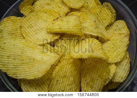 texture of potato chips on a dark background