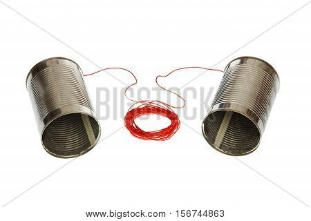 Two tin can phones connected with a cord isolated on white background.