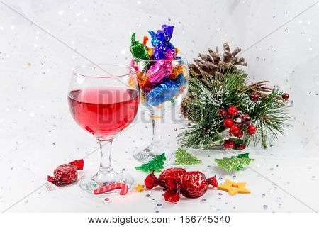 Christmas Party Table Decorations With Wine And Chocolate Sweets.