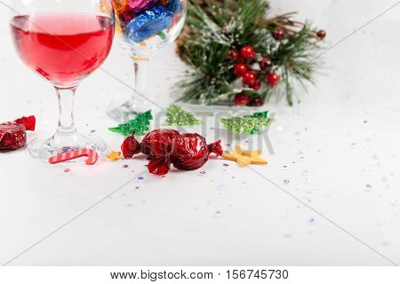 Christmas Party Table Decorations With Wine, Sweets And Copy Space.
