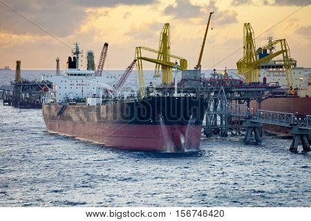 oil tankers unloading at sea in the Caribbean