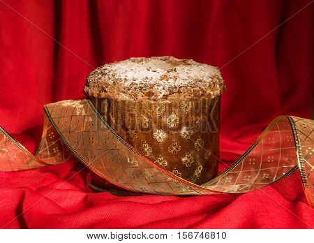 Panettone With Golden Ribbon. Christmas And New Year Theme.