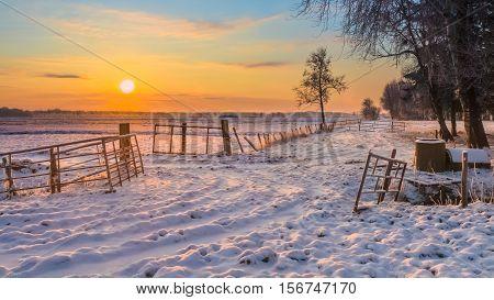 Rising Sun Over Winter Landscape
