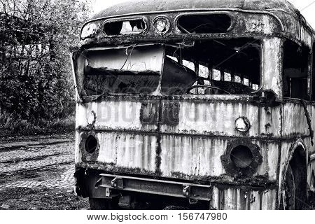 Old abandoned bus wreck. Black and white photo
